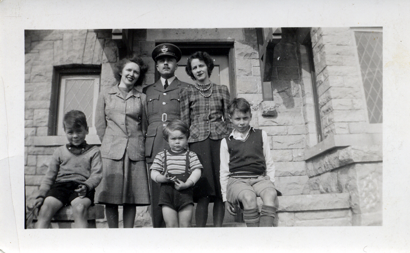 Aplin family taken on the steps in front of their home