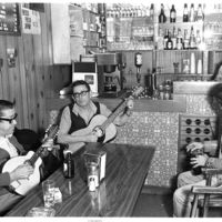Patrons playing guitar at Blue Cafe (Augusta Ave.)