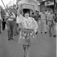 Woman in Portuguese costume marching in Parade 1978