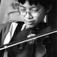 Boy playing violin at St. Christopher House Music School