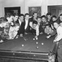 Group of St. Christopher House boys around pool table