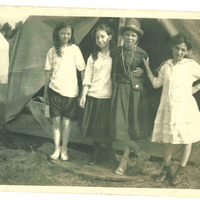 Girls posing in front of tent