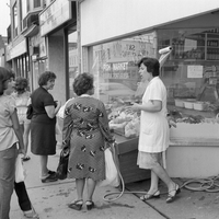 Women in front of Portuguese fish market on Dundas St. West
