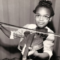 Girl playing violin at St. Christopher House Music School