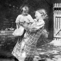 Young girl holding baby at St. Christopher House
