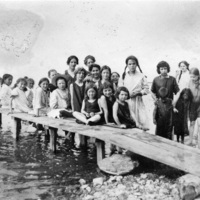 Girls posing on dock at Scugog summer camp