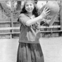 Girl holding ball in backyard at St. Christopher House