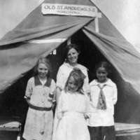 Girls posing in front of tent at Scugog summer camp