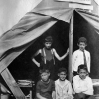 Boys posing in front of tent at Scugog summer camp