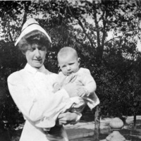 Nurse holding baby at St. Christopher House