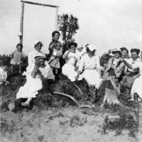 Women sitting and laughing on the beach