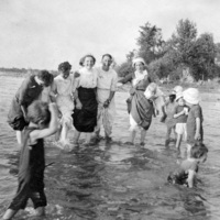 Women and children playing in the lake