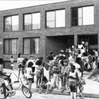 Group of kids in front of St. Christopher House (84 Augusta Ave.)
