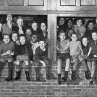 St. Christopher House children on gym windows