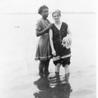 Female couple in the lake at Scugog summer camp