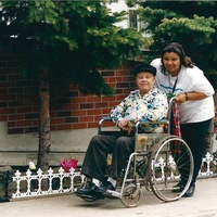 St. Christopher House worker pushing wheelchair