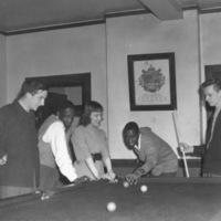 Youth playing pool at St. Christopher House